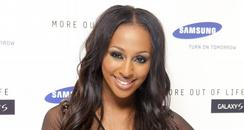 Alexandra Burke poses for photographers