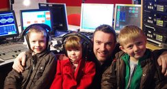 Heart's Ed James with his kids at work