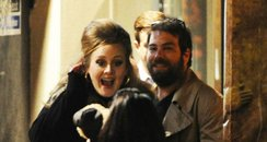 Adele with boyfriend outside restaurant