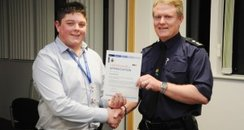 Calum Manton picks up award from Dorset Police
