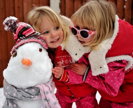 Two girls and their snowman