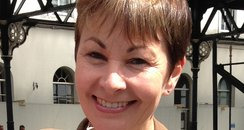 Caroline Lucas collecs signatures at Btn station