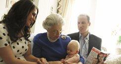Lookalike Prince William and Kate with Baby George