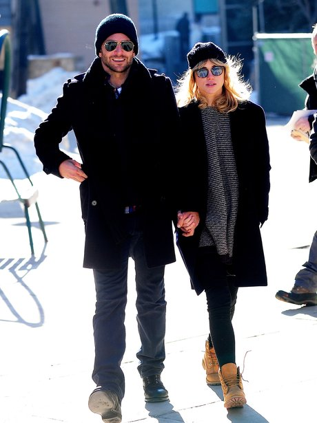 Bradley Cooper and Suki Waterhouse holding hands