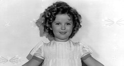 Shirley Temple in a white dress