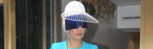 Lady Gaga in white platform shoes and a blue top a