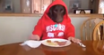 Dog eating with human hands
