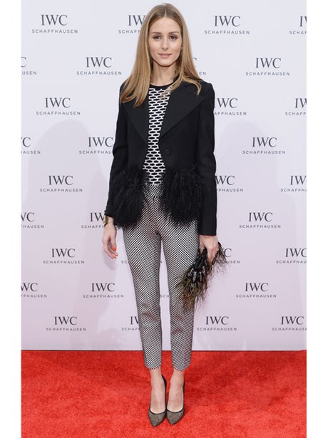 Olivia Palmero on the red carpet in a feathered jacket