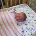 baby April in cot