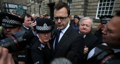 Andy Coulson leaves court
