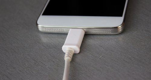 White smart phone in charge