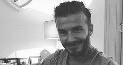 David Beckham with his birthday cake