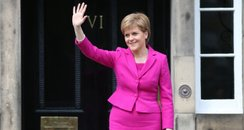 Nicola Sturgeon waves from the steps of Bute House
