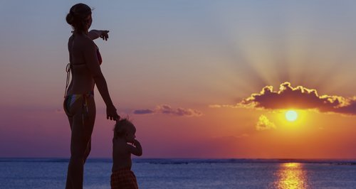 mother baby sunset