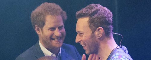 Prince Harry on stage with Chris Martin Coldplay