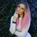 Perrie Edwards dies her hair bright pink.