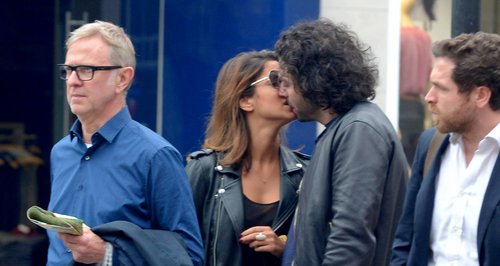 Aidan Turner seen kissing a mystery girl