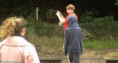 rail risks boy with phone
