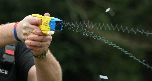 Armed officer using taser